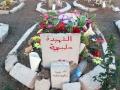 Das Grab eines kurdischen Märtyrers auf einem eigens für Kriegstote eingerichteten Friedhof in der Grenzstadt Qamishli in Nordostsyrien (Foto: Loesche)